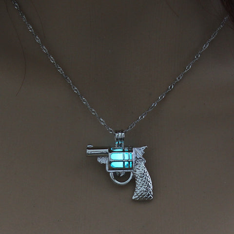 Image of Light Blue Glow in the Dark Vintage Gun Pendant Necklace
