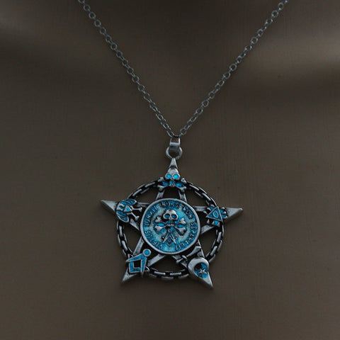 Image of Light Blue Glow in the Dark Star Skull Pendant Necklace