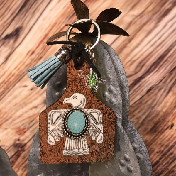 Leather background w/ Thunderbird Livestock Ear Tag Key chain