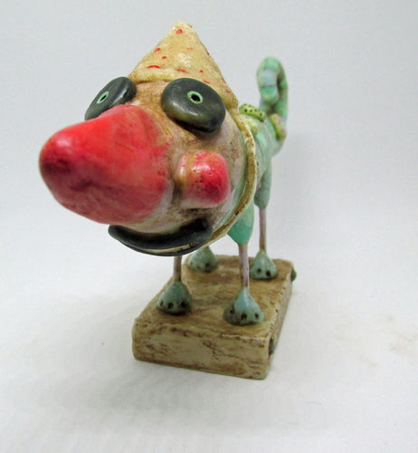 Wacky character with red nose chameleon like