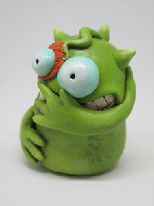 Green belly laugh monster