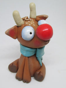 Christmas Reindeer with extra big red nose and bow