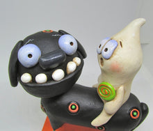 Halloween folk art black dog and ghost rider with candy