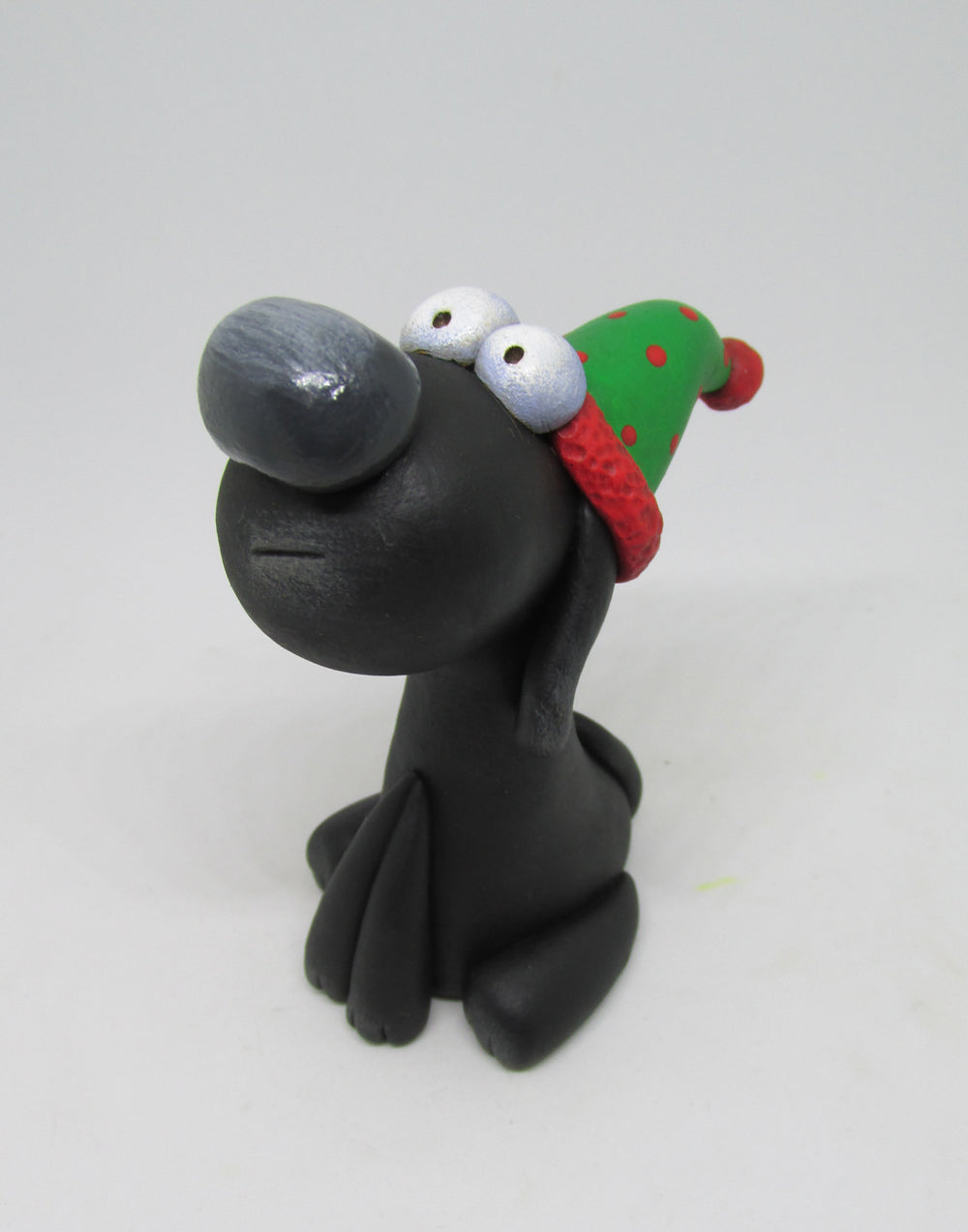 Christmas folk art dog wearing Santa hat with polka dots!