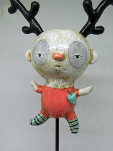 Wacky art character boy with black antlers and fine crackle finish