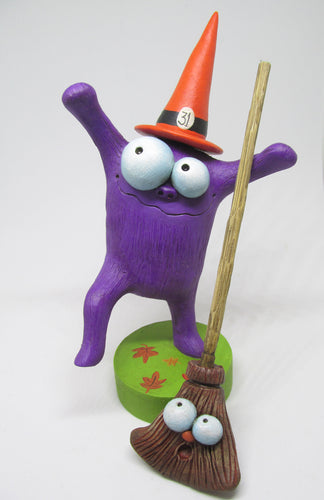 Happy Dancing Halloween Monster with silly broom!