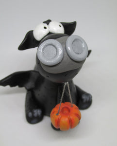 Halloween black dragon and pumpkin bucket