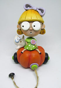 Halloween folk art blonde girl with candy and spooky ghost on pumpkin