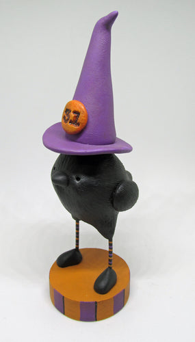 Halloween black bird with a witch hat