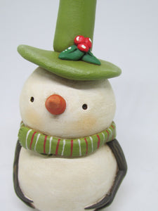 Christmas folk art snowman dressed in olive green colors