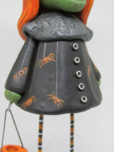 Halloween folk art style witch with orange red hair and jol bucket