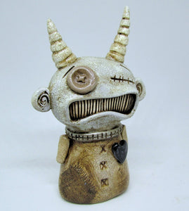 Dark primitive art character with fabulous fine crackle finish