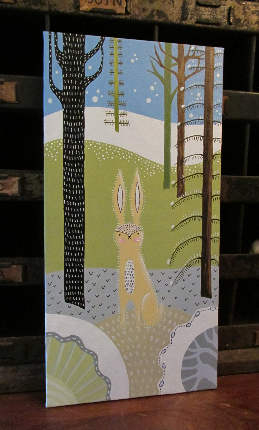 Folk art style painting of rabbit in the woods