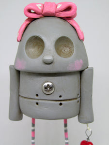 Pretty girl robot with pink heart bow steampunk art character