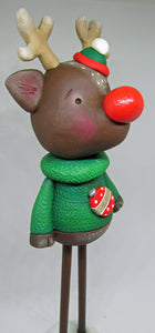 CHRISTMAS reindeer with green sweater tall piece with wooden legs!