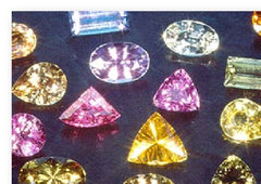 Sapphires of many colours. Pink, yellow, green, blue.