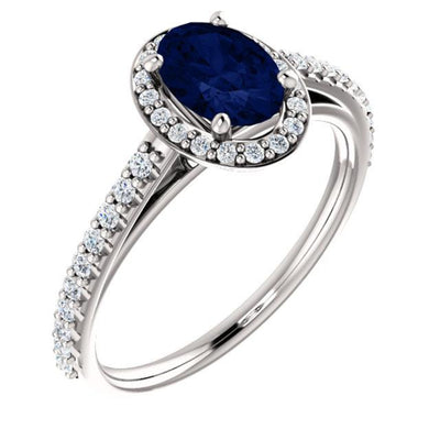 White gold Blue Sapphire Oval cut with diamond halo ring