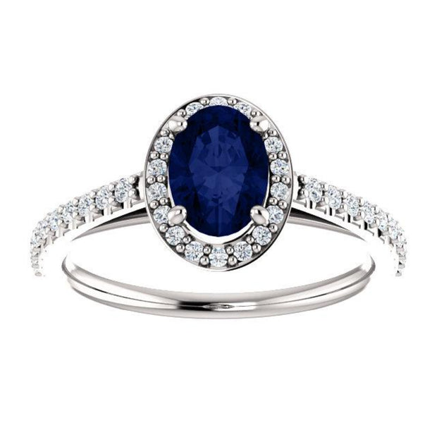 White gold Blue Sapphire Oval cut with diamond halo ring, top view.