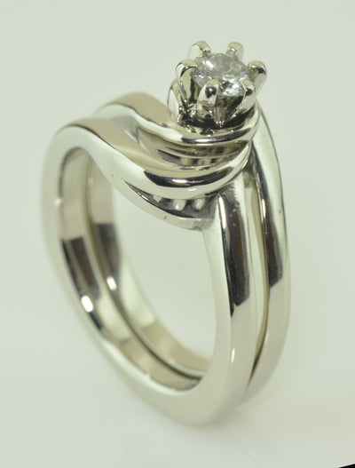 14K White Gold Diamond Wedding set with fitted band which swirls around the base of the diamond centre stone.