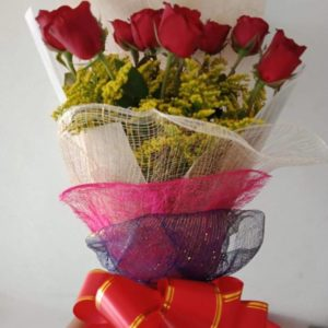 12 red roses with fillers in a Bouquet