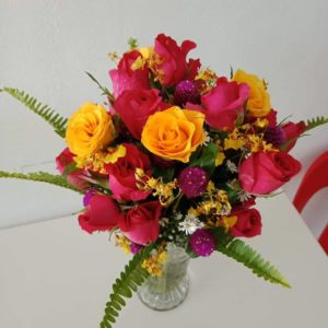 12 pcs mix colored roses in a vase