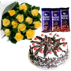 1 Dozen Yellow Roses with 3 pcs Cadburry and Black forest cake from Goldilocks