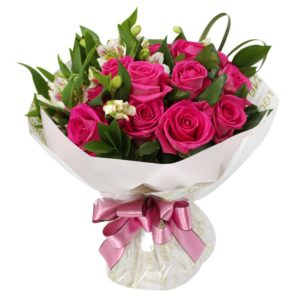 1 dozen Pink Holland Roses in a Bouquet