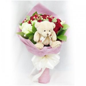 1 dozen Red Holland Roses with Mini Teddy Bear in a bouquet