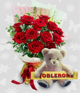1 dozen Red Holland Roses with Teddy Bear 4″ inches and Toblerone 100g