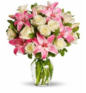 1 dozen White Holland Roses with 2 Pink Stem Lilies in a Vase