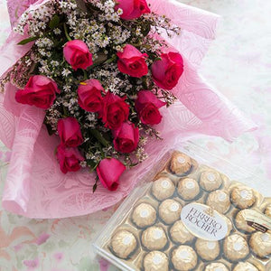 1 doz pink roses in a bouquet and 24pcs ferero