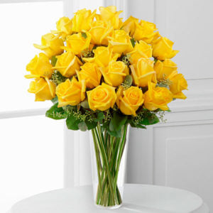 2 dozen Yellow Holland Roses in a Vase