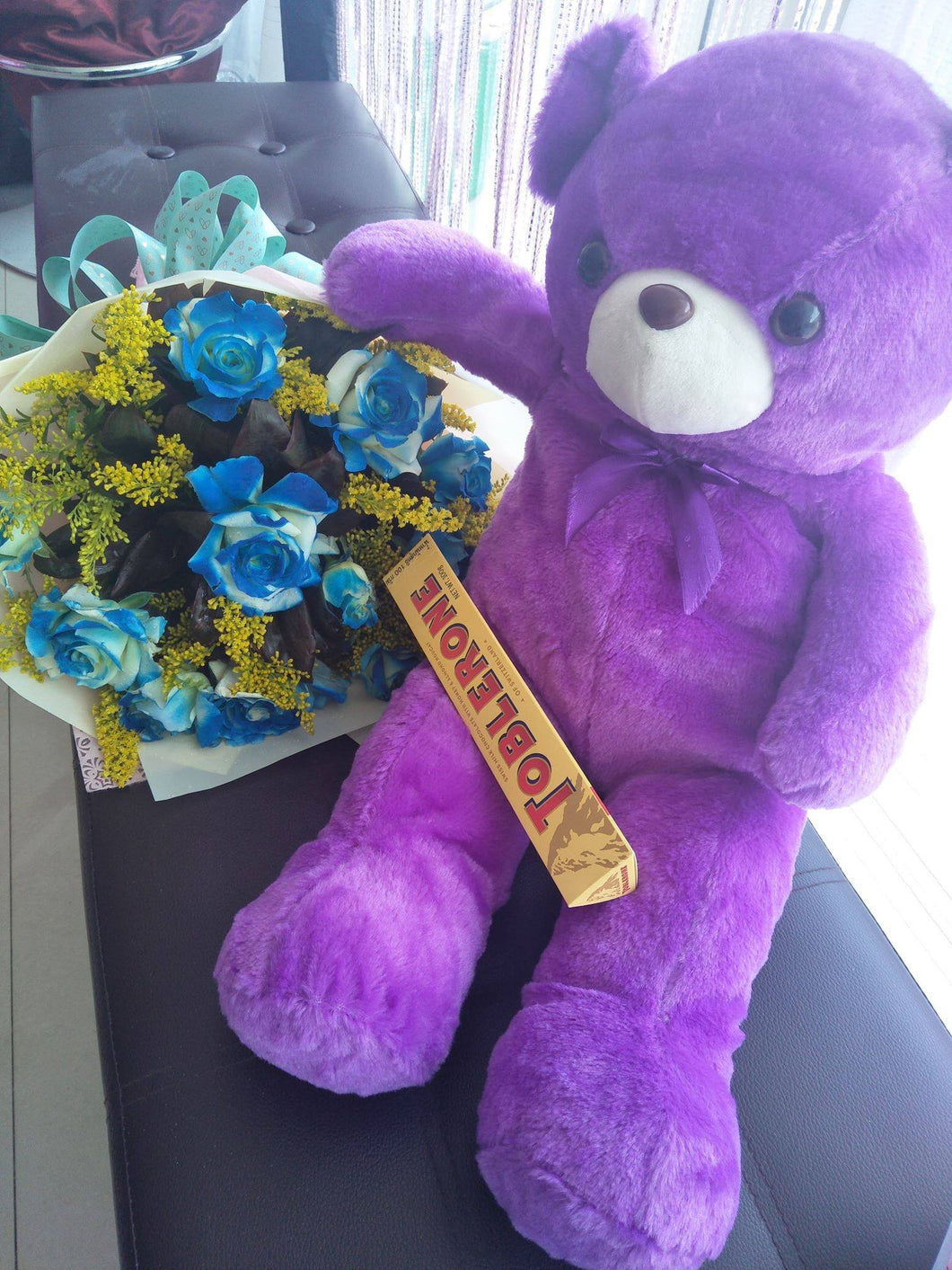 Purple 16inch Teddy with 1 Dozen Blue Roses and 100g Toblerone