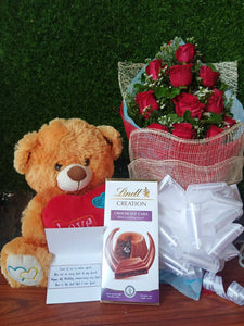 Lindt bar with 1 Dozen Red Roses and  Teddy 16inch