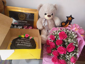 1 Dozen Roses in a  Pink Bouquet with Chocolate Dedication cake and Beautiful 16