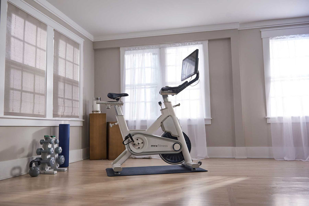 Photo of the white myx bike in a home setting