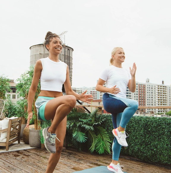 Women working out outdoors with heart rate monitors