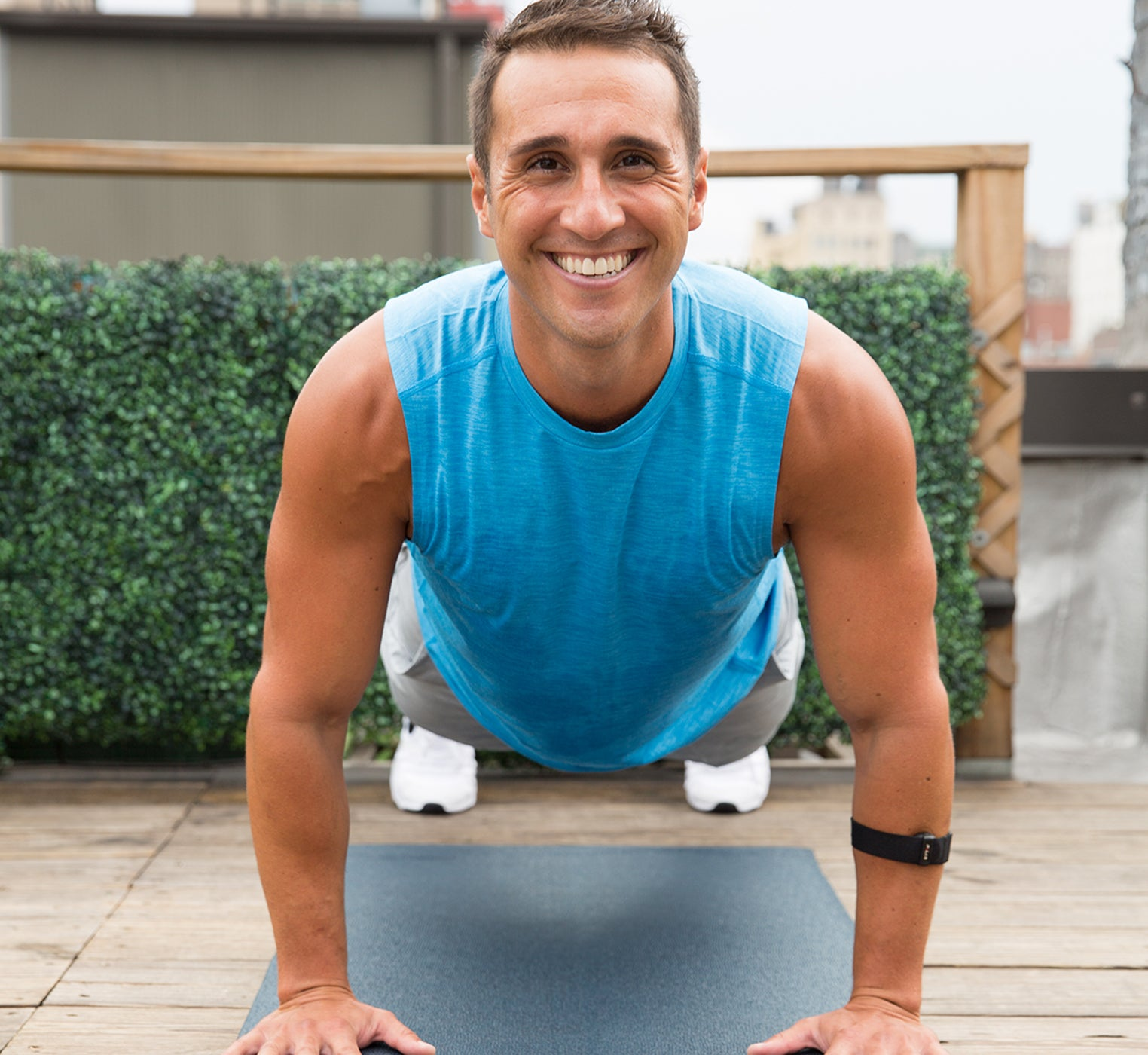 Man in plank position smiling