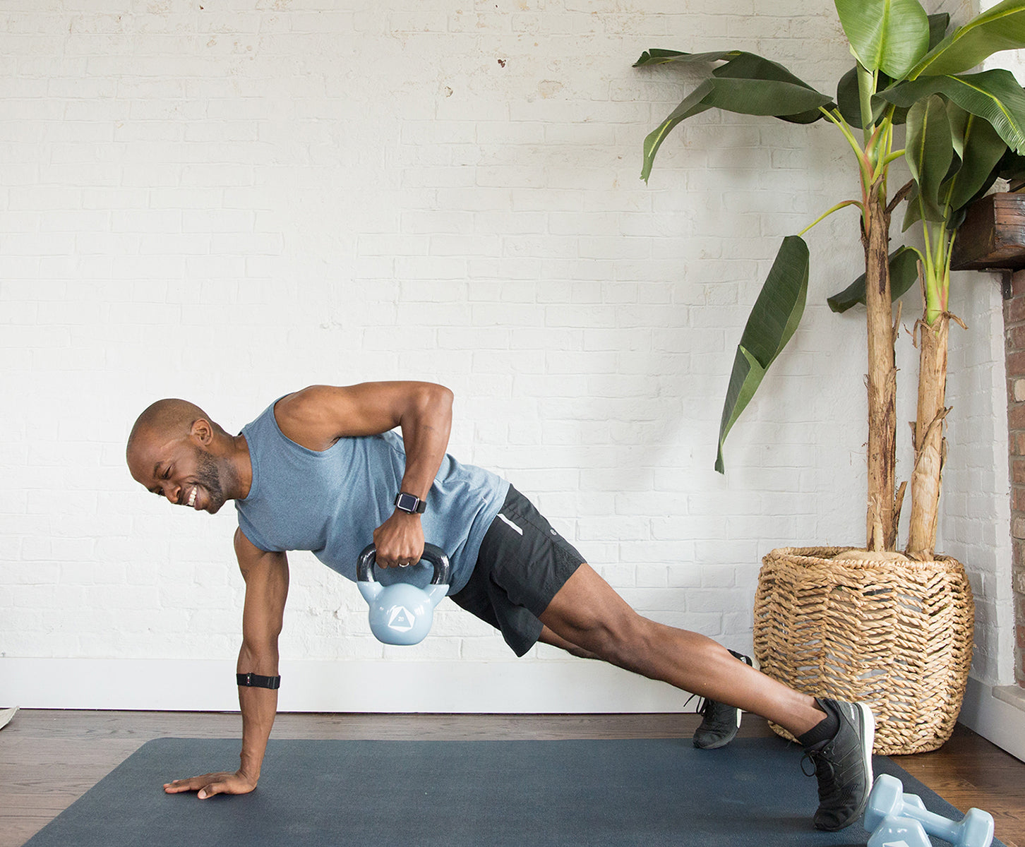 Man working out on floor with kettlebell