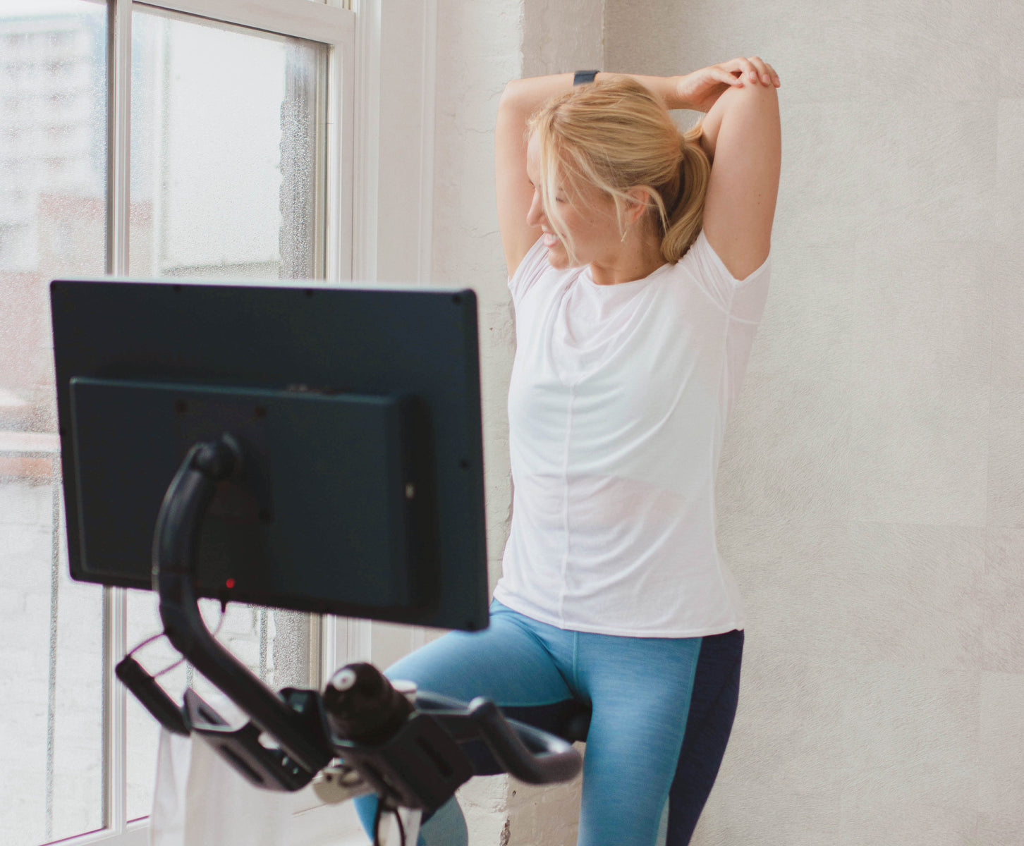 Woman working out on stationary bike