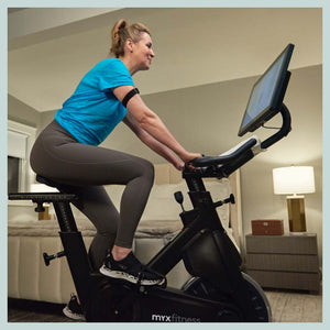 MYX Member riding the exercise bike