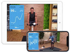 Screens of the MYX app on both an iPhone and iPad showing the MYX coaches one an the exercise bike the other lifting the dumbbells.