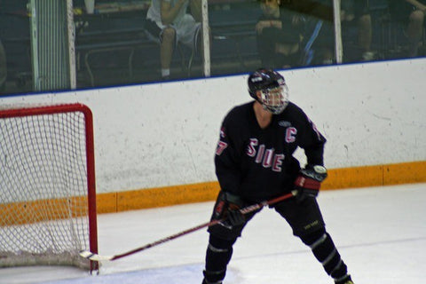 Joey Thurman playing hockey
