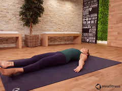 woman doing yoga savasana pose
