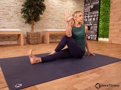 woman doing yoga seated spinal twist pose