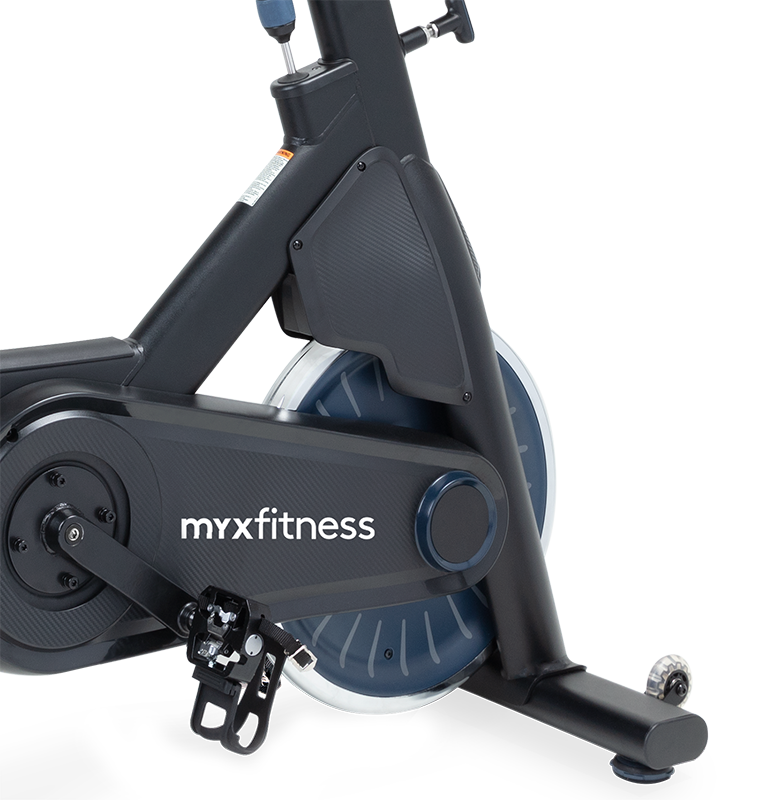 Stationary indoor exercise bike with SPD clip-ins