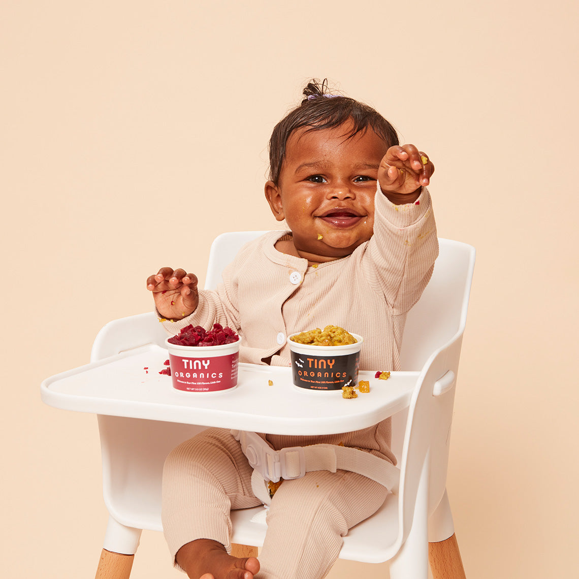Baby on high chair with oatmeal