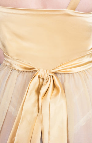 Closeup of the silk satin waist tie for the Josephine Babydoll in gold