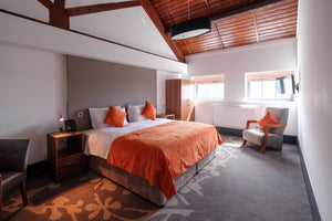 Orange and grey bedroom in a hotel, showing our contract bedroom furniture