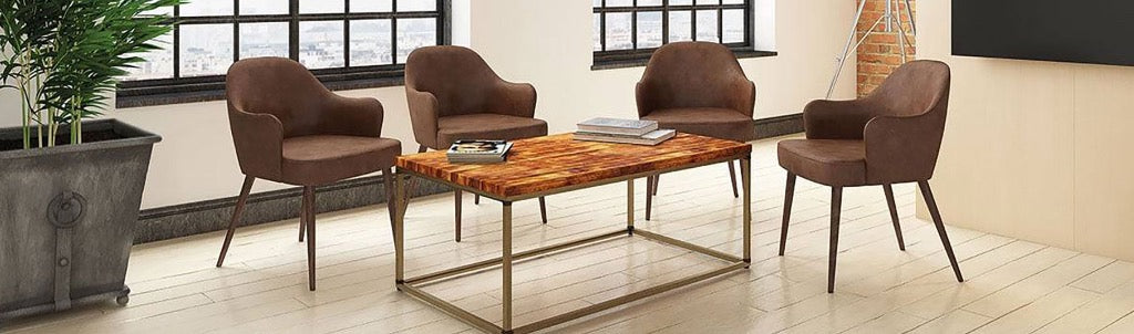4 brown chairs around a wooden and metal coffee table in a commercial setting